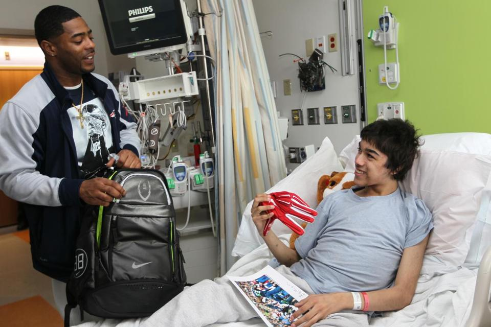 Super Bowl hero Malcolm Butler (left) brought a smile to patient Damian Ortiz at Children's Hospital on Friday.